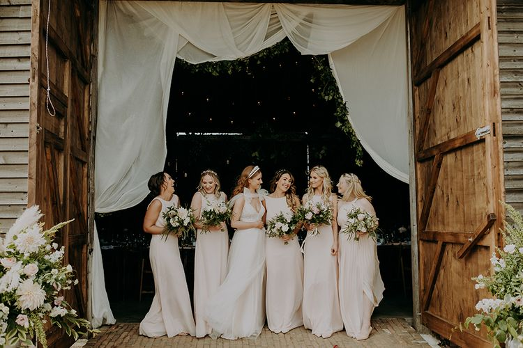 Bridal party portrait with bridesmaids in blush pink dresses
