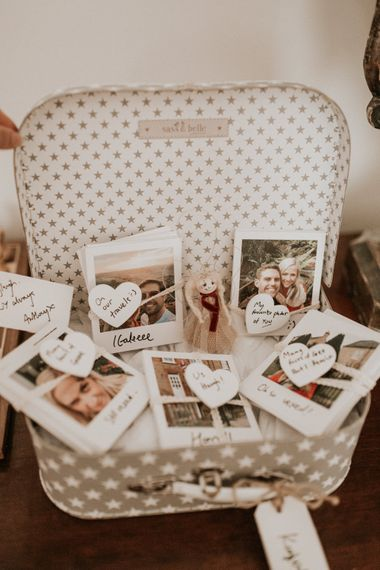 vintage suitcase filled with polaroid pictures