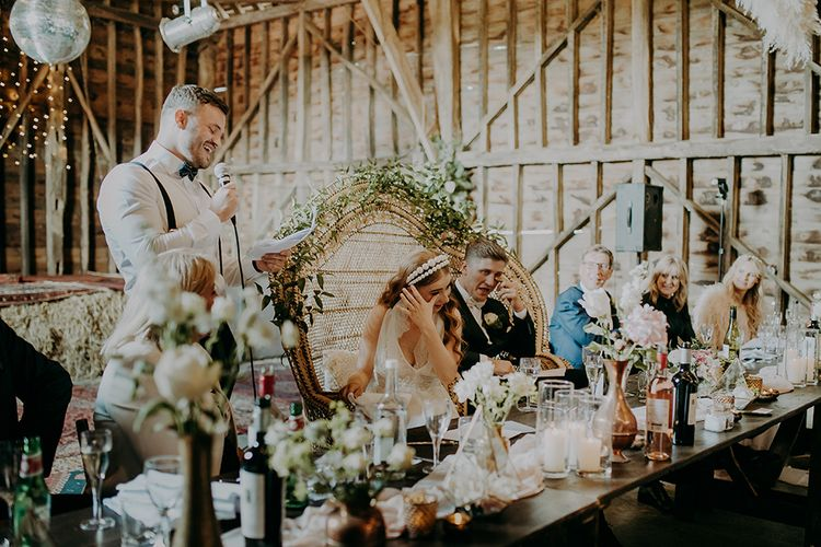 Best man delivering his wedding speech at the barn reception