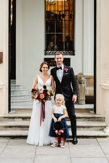 Bride anf groom with flower girl at Carlton House Terrace wedding