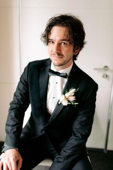 Groom on his wedding day with black tie wedding theme