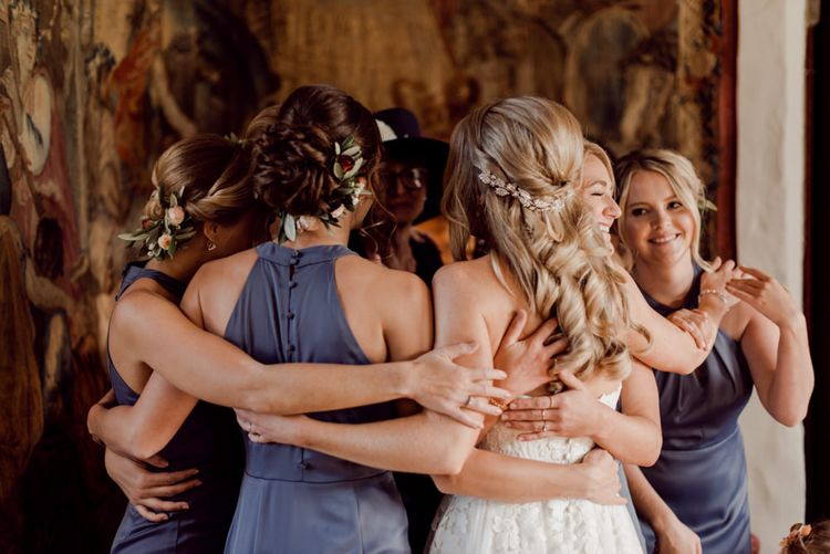 Bridal party hug before ceremony