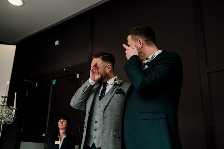 Emotional grooms during wedding ceremony at Titanic Hotel Liverpool