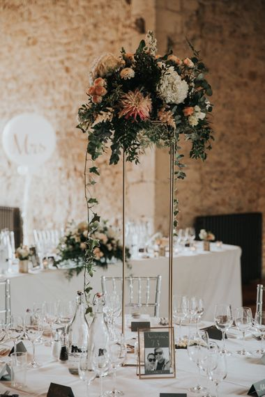 Tall floral centrepieces for Notley Abbey wedding