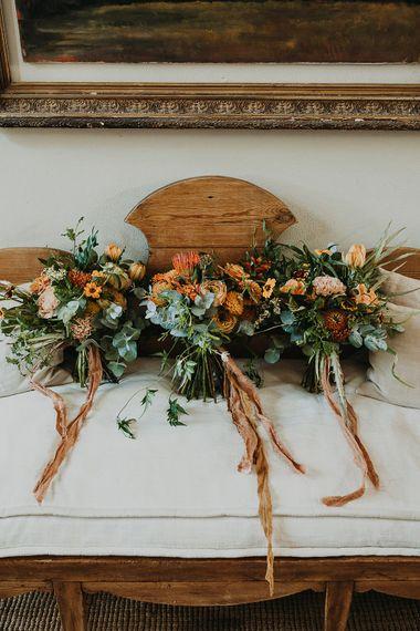 Orange and green wedding bouquets