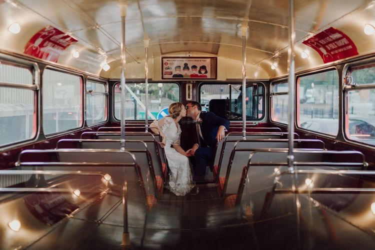 Bride and groom on London bus