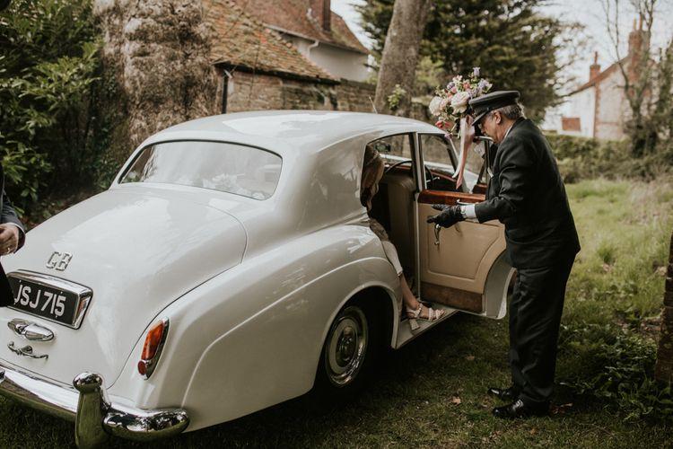 Bridal entrance in vintage white wedding car