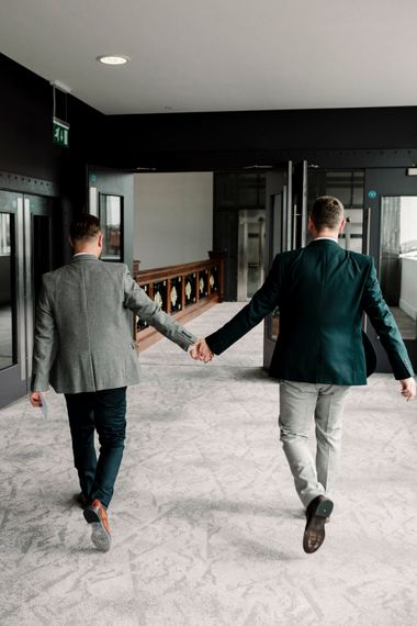 Grooms in grey and green suits at Titanic Hotel Liverpool wedding
