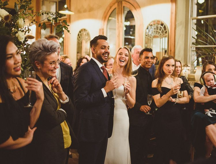 Bride and groom speeches at Chelsea wedding with Champagne
