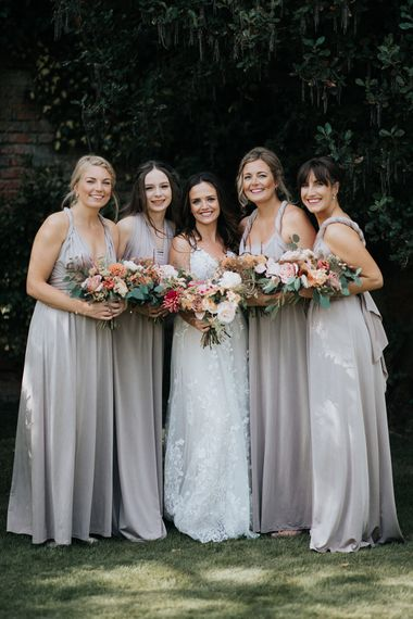 Bridal party portrait with bridesmaids in dusky pink dresses