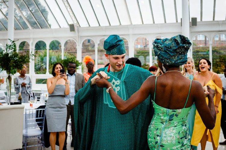 Bride and groom first dance in Nigerian outfits