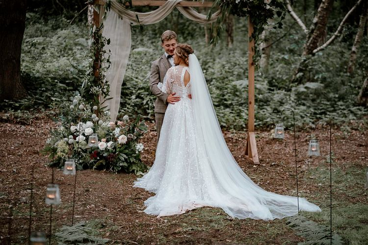 Bride in bespoke wedding dress at woodland wedding in Sherwood Glade