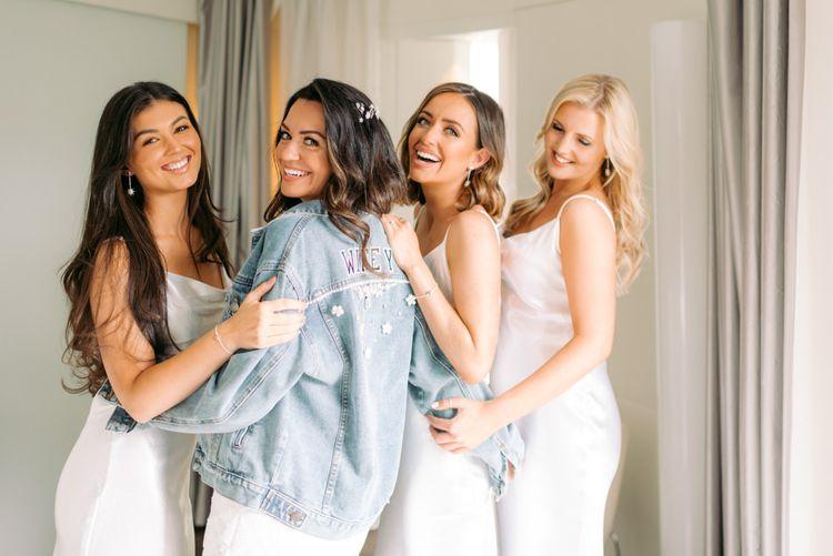 Bride Squad with bride wearing personalised denim jacket
