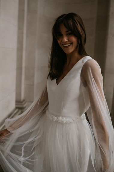 Sheer long sleeves and ruffled waist detail by Story Of My Dress