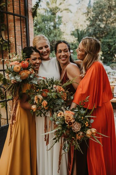 Bridal party in earthy toned dresses hugging