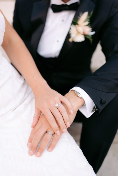 Close up shot of newly wed couple's wedding rings