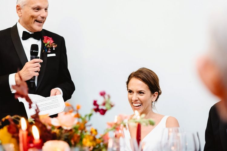 Bride smiling during the Father of The Bride speech