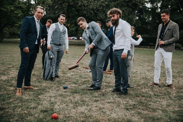 Garden games at Notley Abbey summer wedding