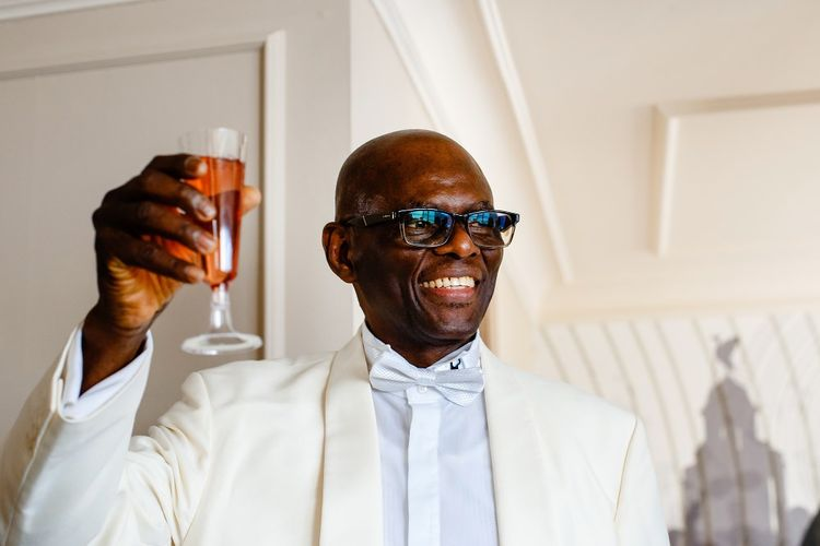 Father of the bride in white dinner jacket