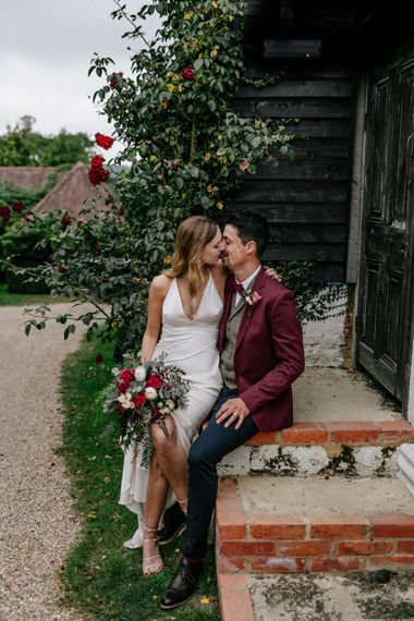 Bride and groom kissing at High Billinghurst Farm wedding