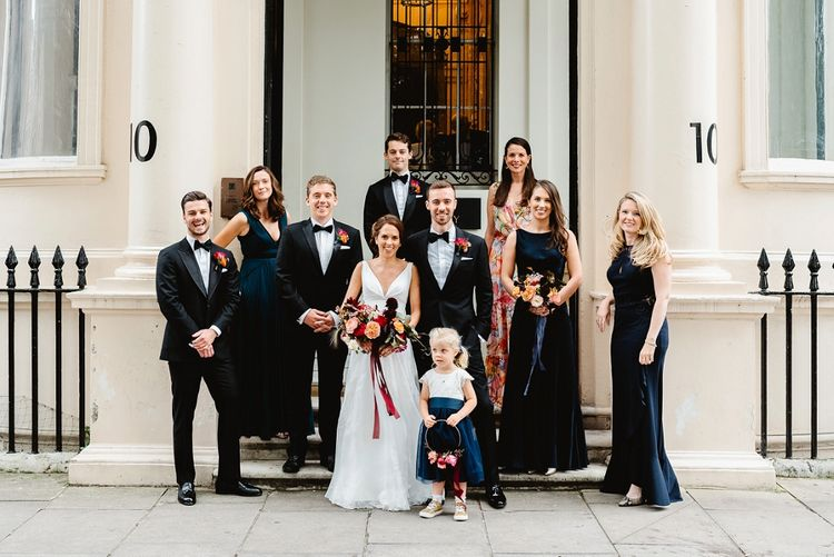 Wedding party gathered on the steps at Carlton House Terrace