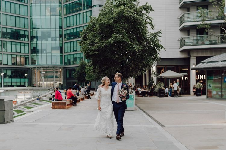 Bride and groom at city wedding with London wedding bus
