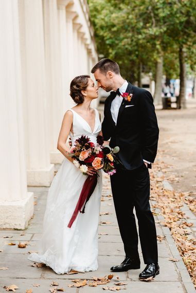 Bride and groom at autumn black tie wedding in London