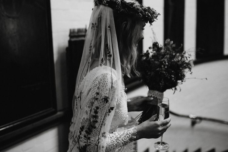 Boho bride with flower crown, and embroidered veil