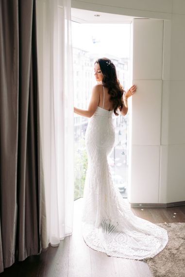 Opaque white embellished wedding dress with halter neck silhouette wedding gown with scalloped hem