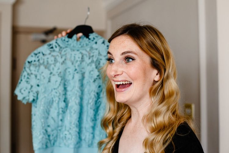 Happy bridesmaid with wavy hair on the wedding morning