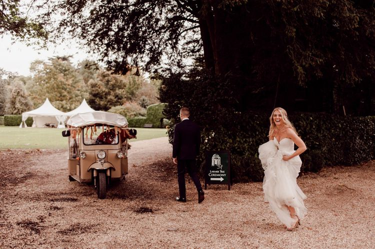 Bride and groom make their way to dinner at Larmer Tree Gardens Wedding