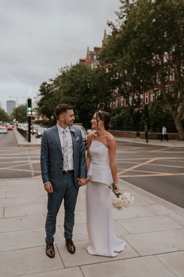 Bride in Roland Mouret wedding dress and groom in blue suit