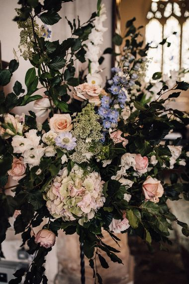 Pastel coloured church wedding flowers