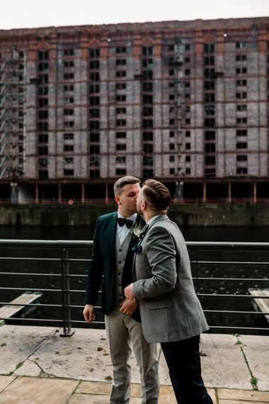 Grooms kissing at at first look on the Stanley docks