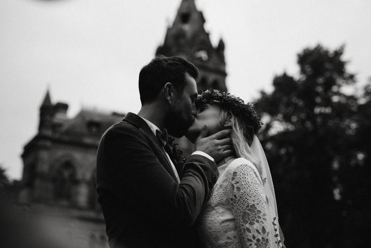 Black and white portrait of bride and groom kissing in Chester Town