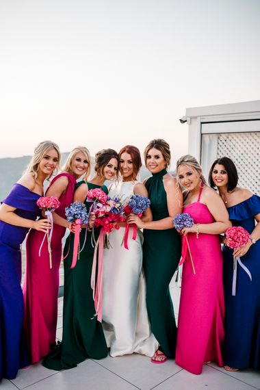 Bridesmaids in jewel coloured dresses for Santorini wedding