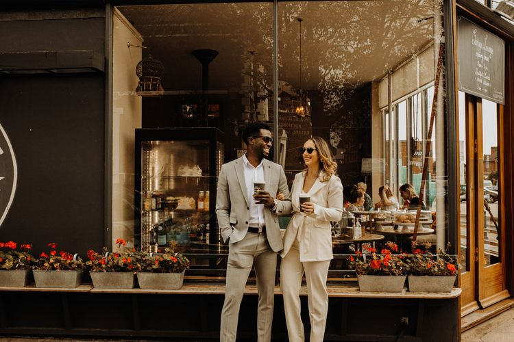 Bride and groom enjoying coffee outside their favourite cafe after their city elopement