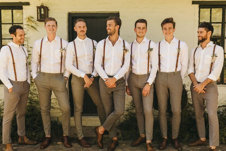 Groomsmen in white shirts and braces for South Africa wedding