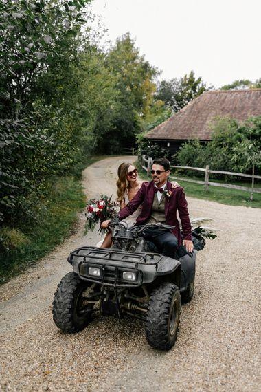 Bride and groom riding a quad bike at High Billinghurst Farm