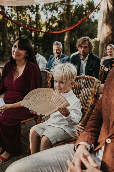 Page boy with wooden fan favour for Andalusia wedding