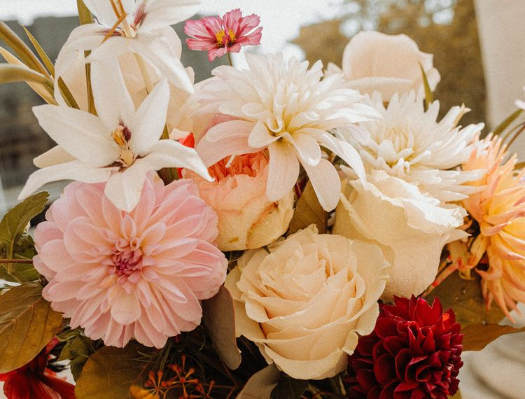 Ivory and pink dahlia and rose wedding bouquet