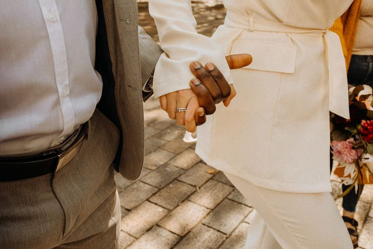 Bride and groom holding hands at Portsmouth Guidhall city elopement