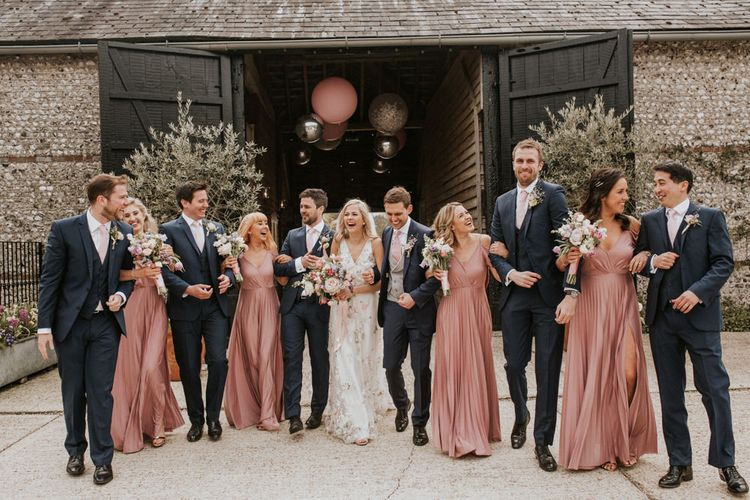 Wedding party portrait in pink and navy outfits
