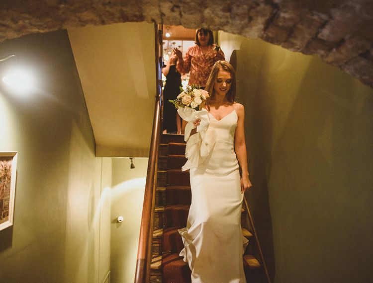 Bride walking down the stairs before her wedding day in Chelsea