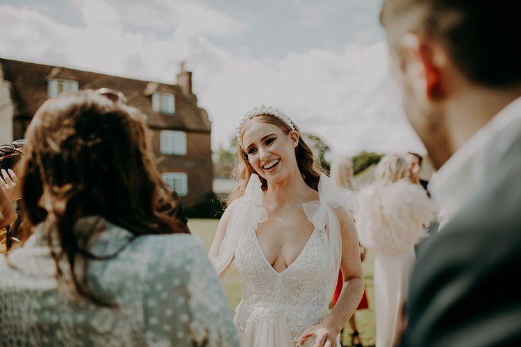 Bride in Inbal Dror wedding dress and pearl headband