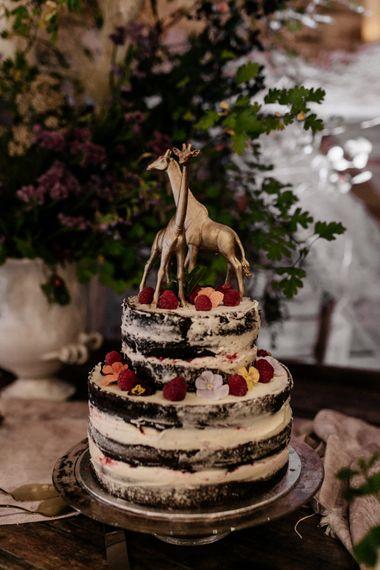 Semi naked chocolate wedding cake with giraffe cake topper