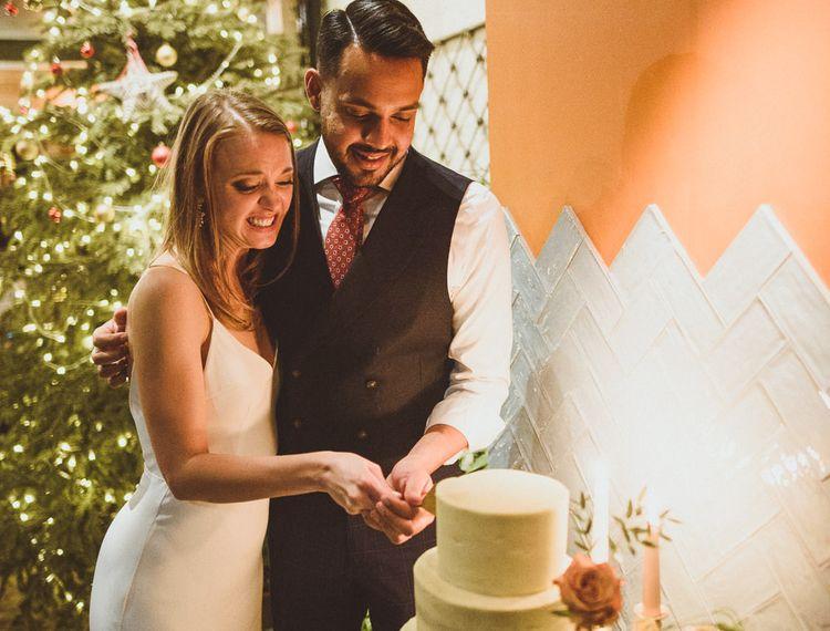 Three tier white wedding cake for a Christmas wedding