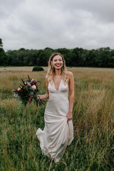 Bride in highstreet wedding dress at High Billinghurst Farm wedding