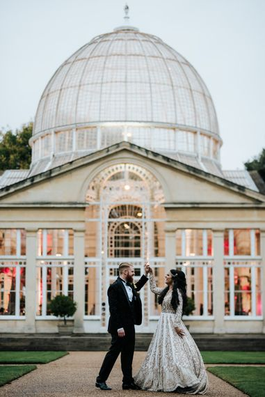Bride and groom dancing in front of their Syon Park Orangery reception