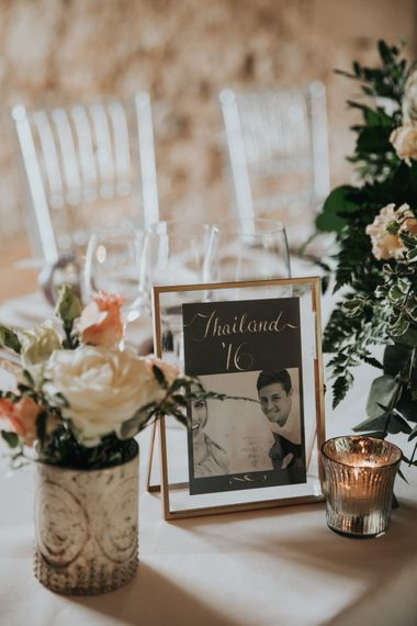 Table names in gold frames named after destinations the couple have travelled together